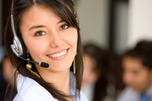 Non Profit Insurance Florida - beautiful business customer service woman smiling in an office
