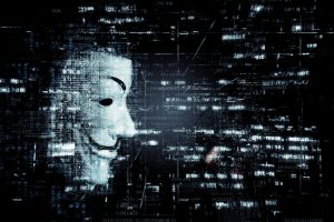 Cyber Liability Insurance Mount Pleasant SC - Guy Fawkes mask floating in sea of digital code